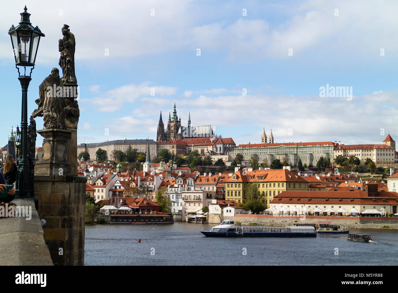 Prague; Czech Republic - October, 6, 2017: Prague castle seen from the Charles Bridge with the river Moldau and - Stock Image