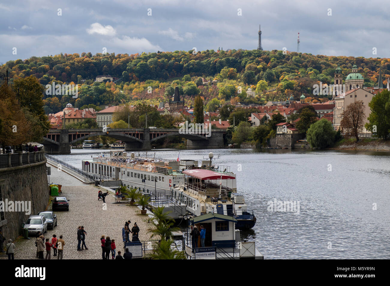 Prague, Czech Republic - October 8, 2017: Launches and tourists on the Moldau river in Prague in autumn with the - Stock Image