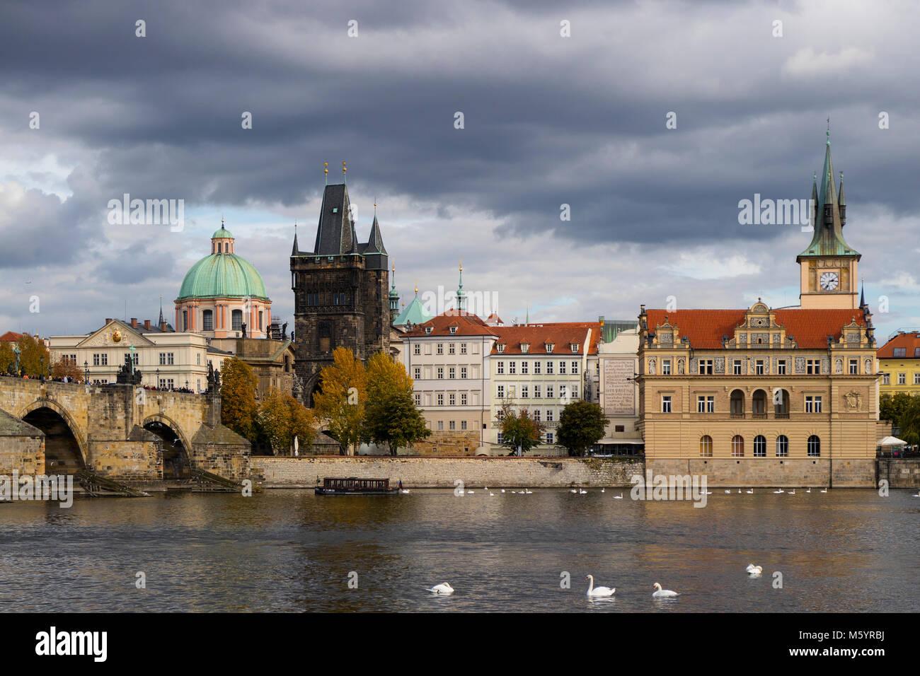 Prague, Czech Republic - October 9, 2017: Classic Czech buildings and Smetana Museum along the Vltava River in Prague - Stock Image