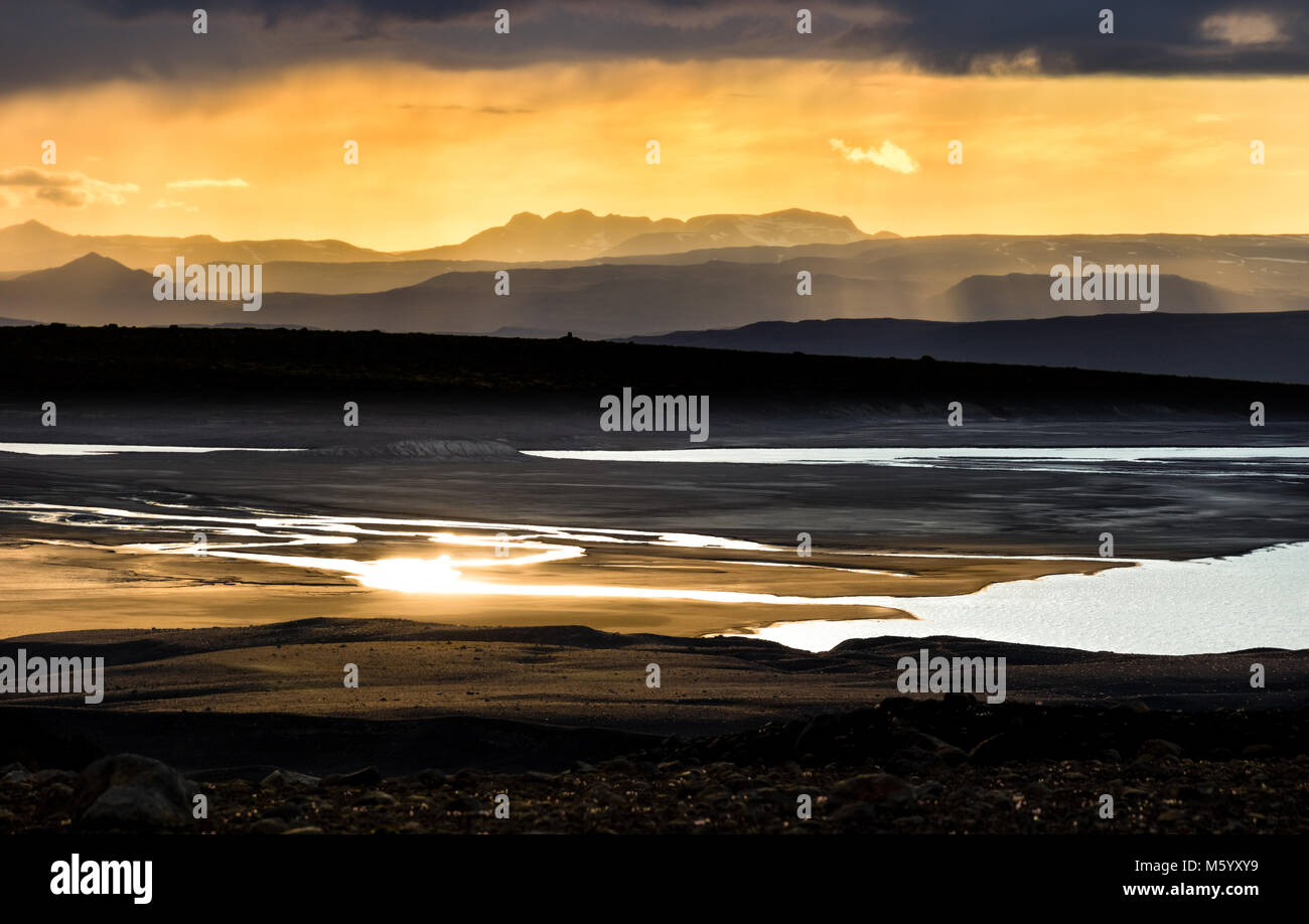 Colorful sunset over mountains, river and lake. Fantastic view. Iceland. - Stock Image