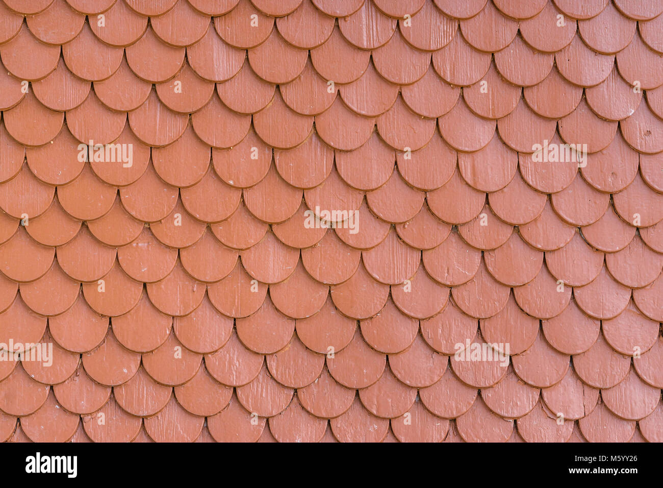 Red painted wood tiling roof wall texture background - Stock Image