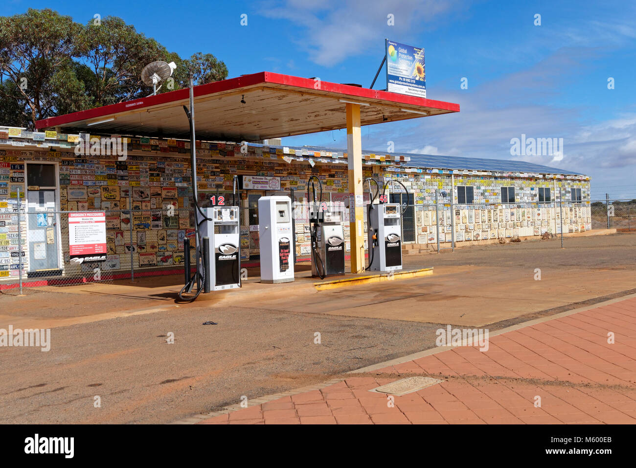 Fuel station with walls covered in car number plates and Australian Memorabilia, Menzies, Murchison, Western Australia - Stock Image