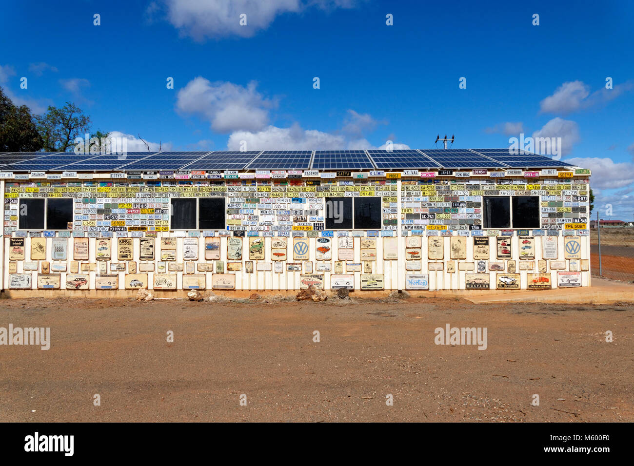 Wall covered in car number plates and Australian Memorabilia, Menzies, Murchison, Western Australia - Stock Image