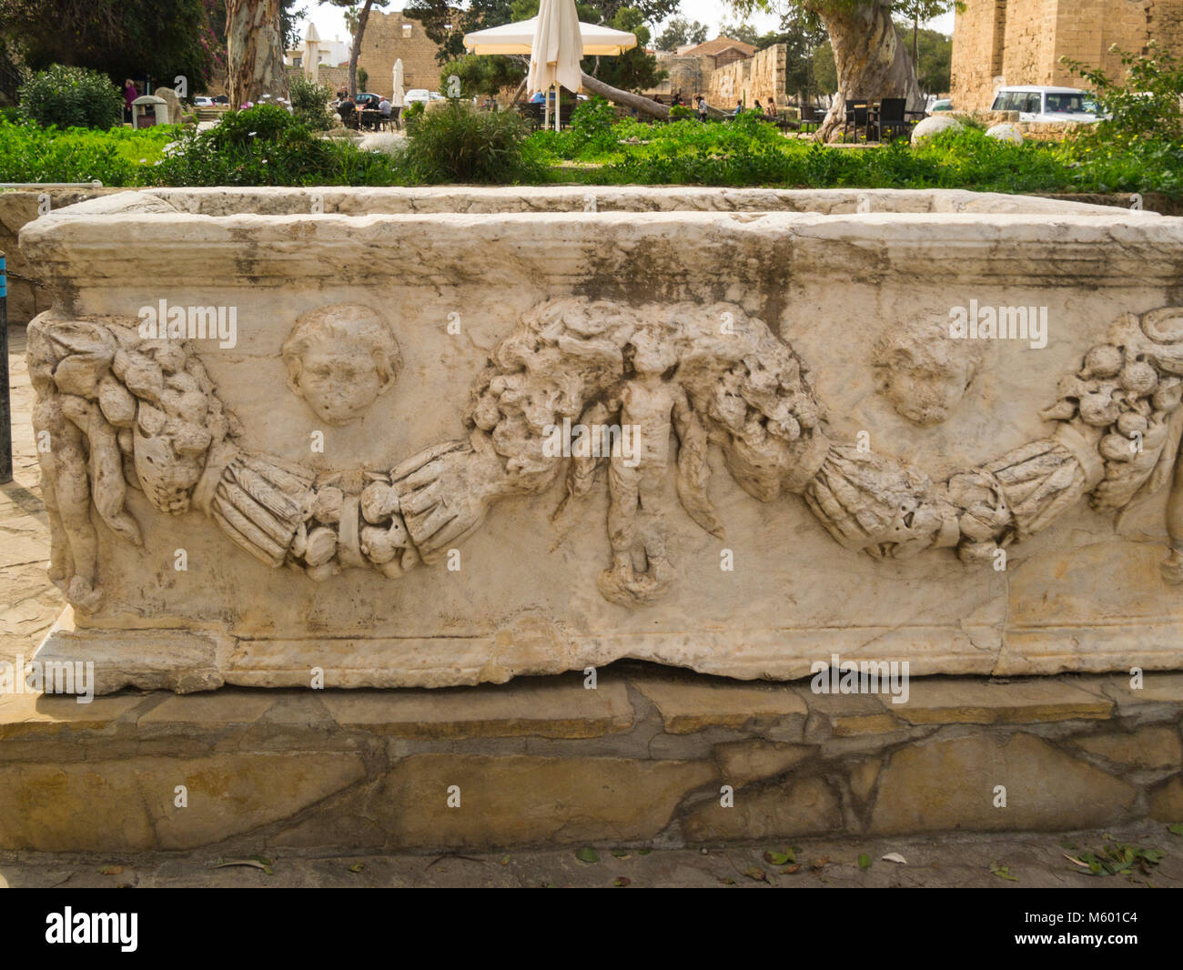 Lovely carved stone Sarcophagus a box like  funeral receptacle for a corpse in Venetial Royal Palace ruins Famagusta - Stock Image