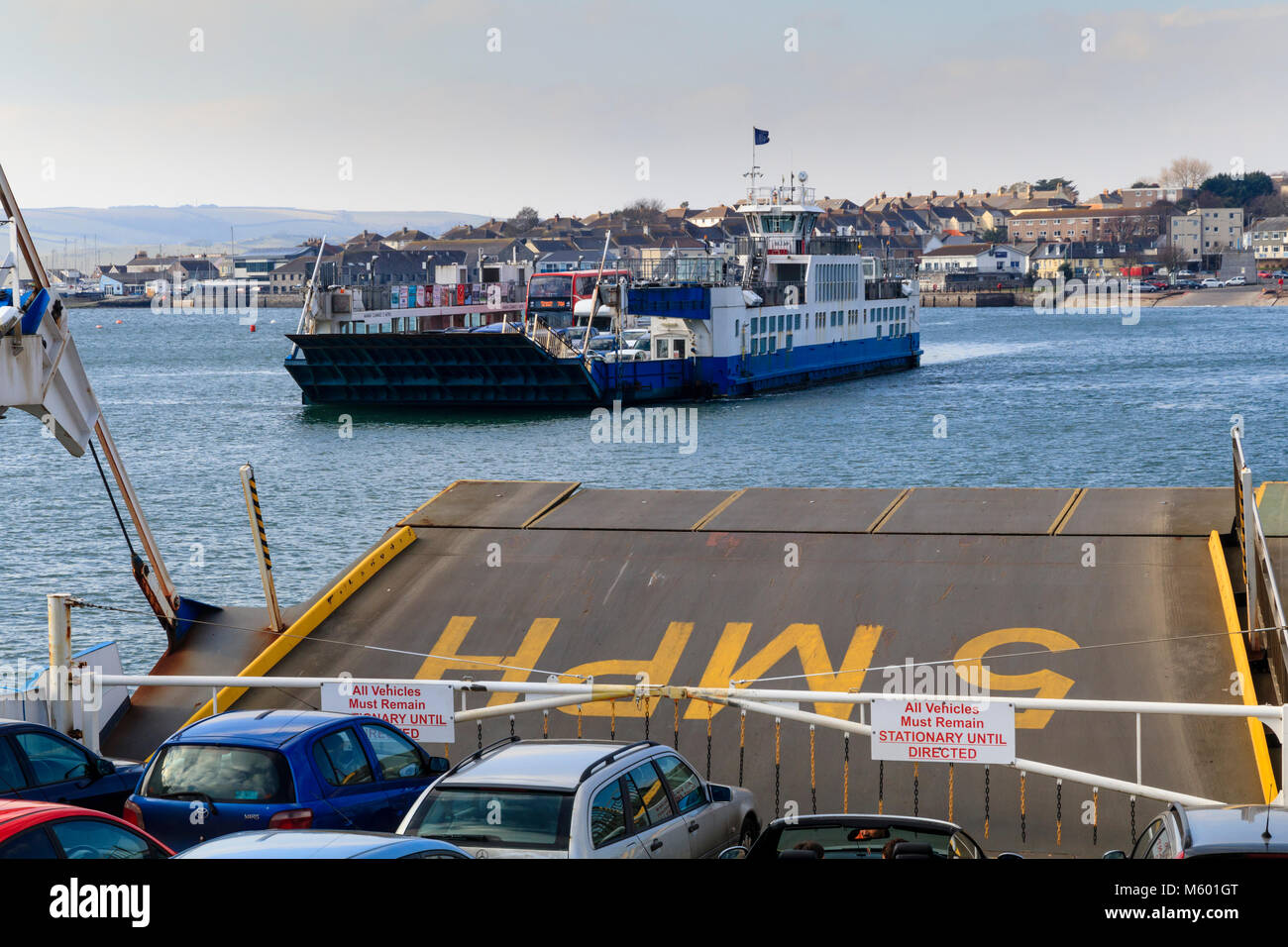 Chain ferries passing while  crossing the River Tamar from Plymouth to the Cornish town of Torpoint Stock Photo