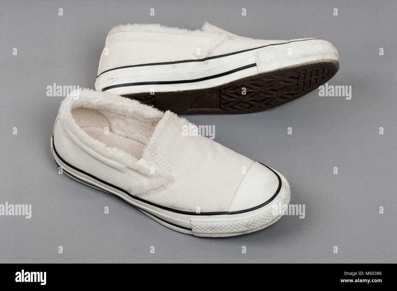 closeup white women canvas sneakers