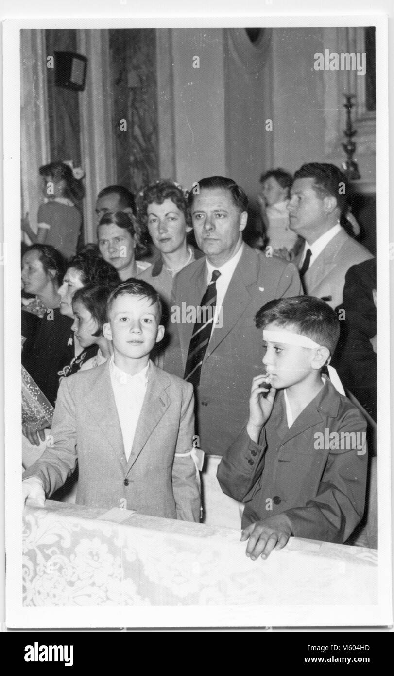 1960s 1970s wedding caucasian relatives during a church ceremony. Black and white shot. Italy - Stock Image