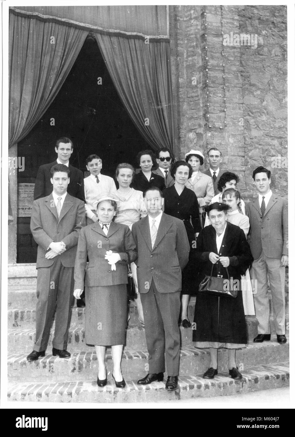 1960s 1970s wedding caucasian relatives outside the church ceremony. Black and white shot. Italy - Stock Image