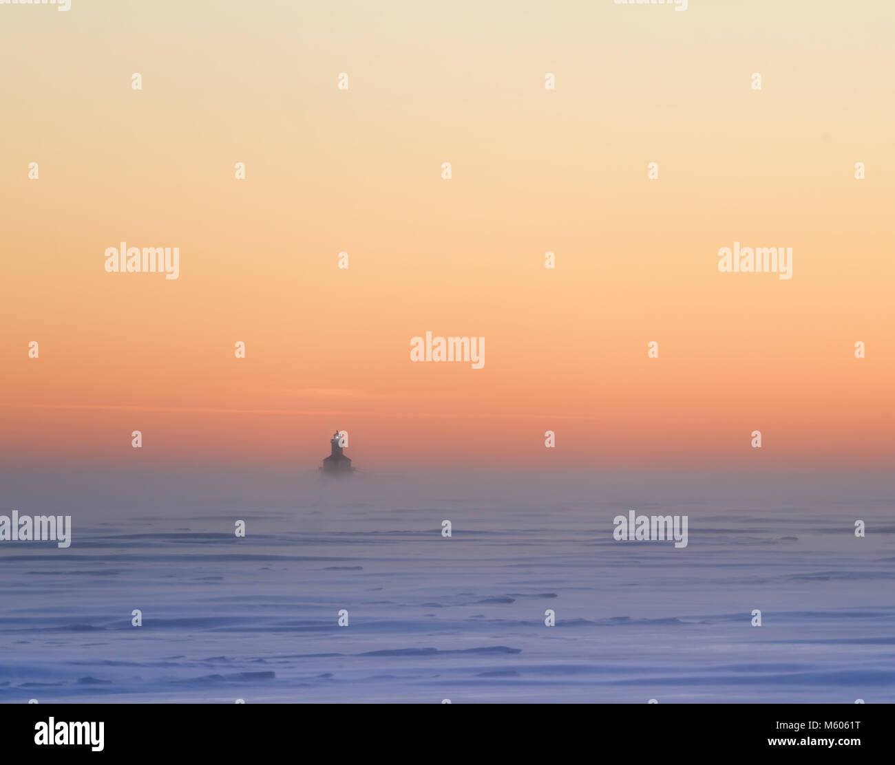 Wind storm raging at sunset in a frozen harbour in rural Prince Edward Island, Canada. Stock Photo