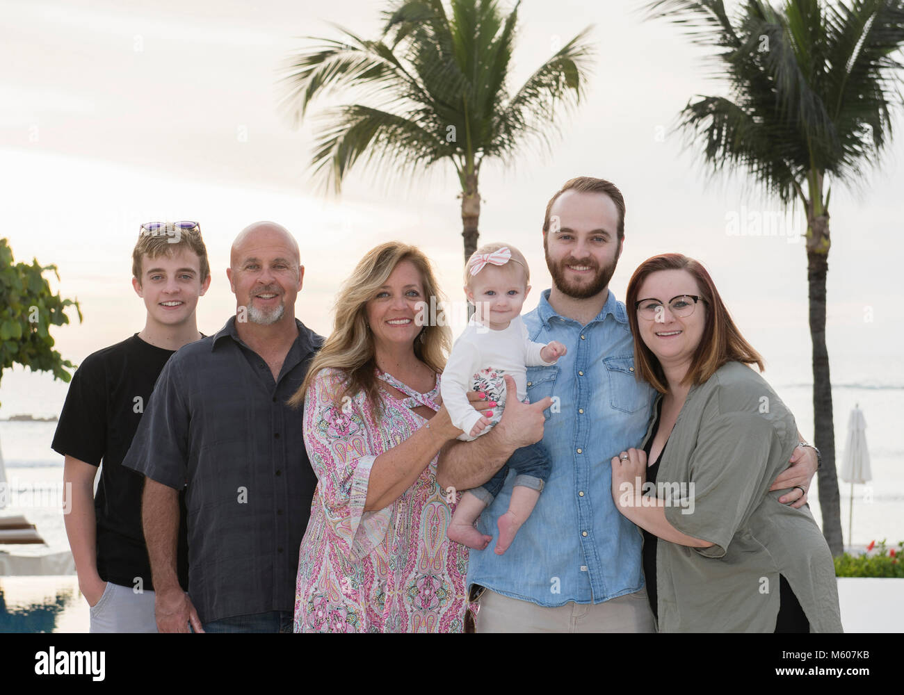 Happy Extended Family on Vacation & the Beach at a Resort in Mexico - Stock Image