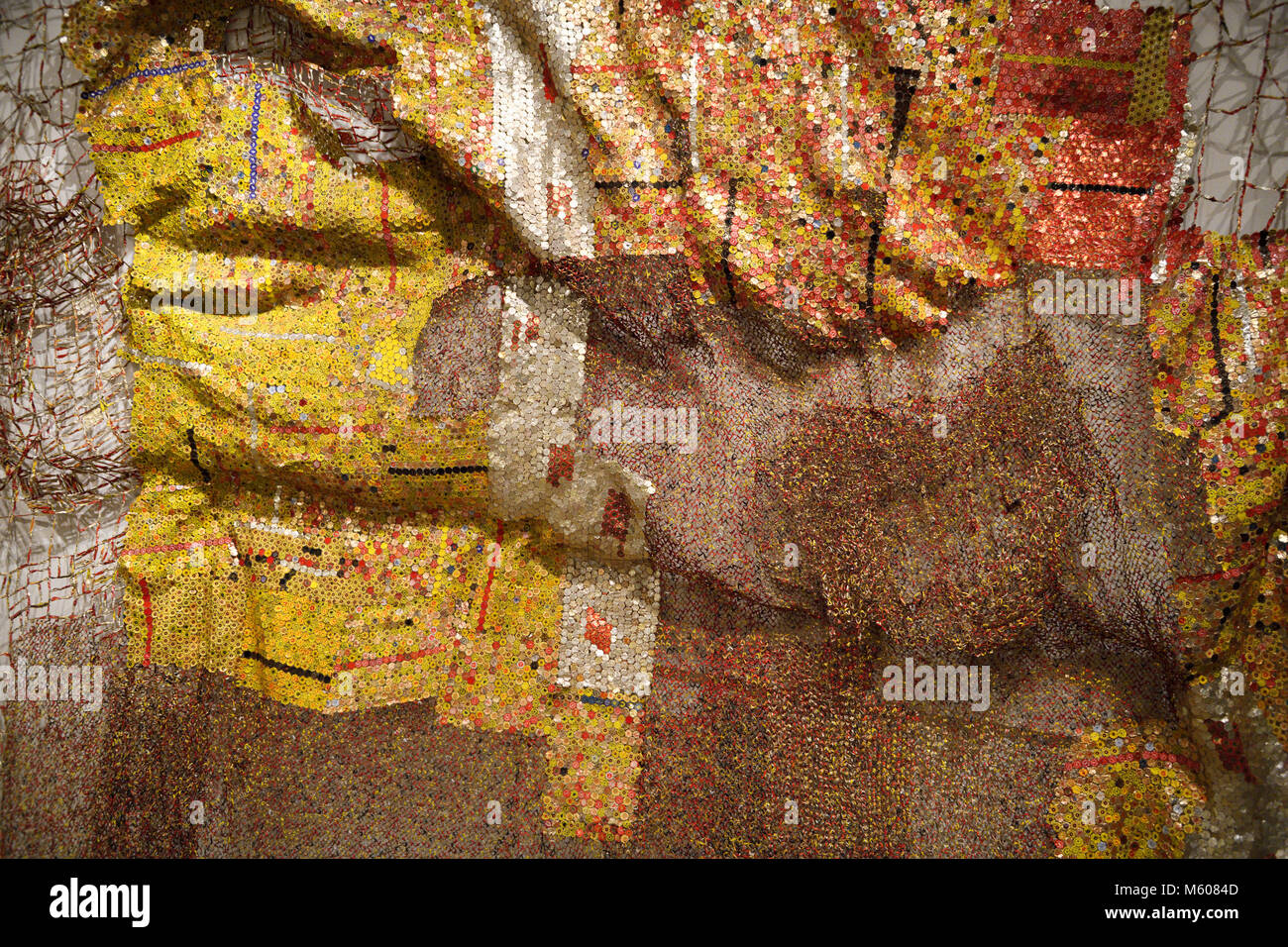 Metal tapestry by African artist El Anatsui using aluminum liquor bottle tops and copper wire at the Toronto Royal - Stock Image