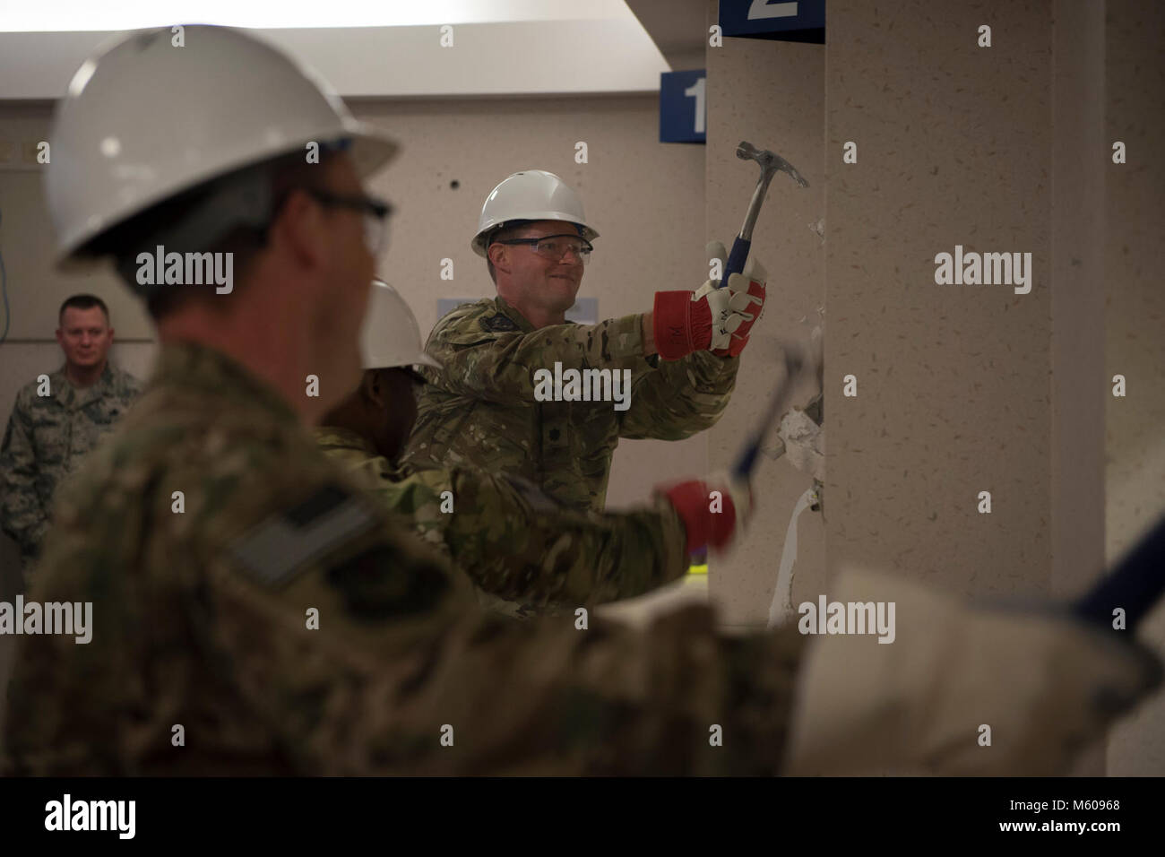 Air Commandos attend the 1st Special Operations Medical Group wall breaking ceremony at Hurlburt Field, Fla., Feb. - Stock Image