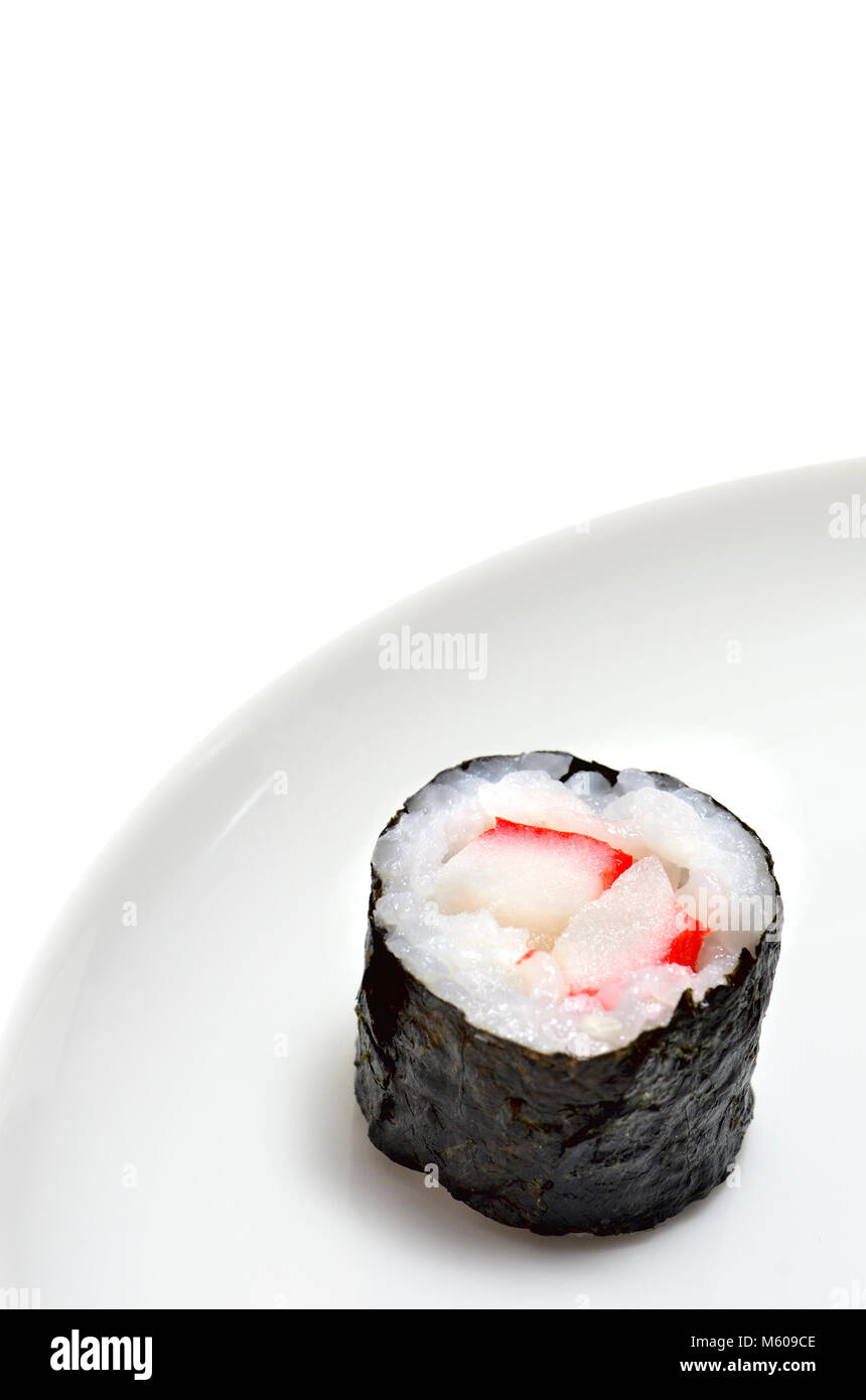 Sushi on a white plate: Maki (roll wrapped in seaweed) - Stock Image
