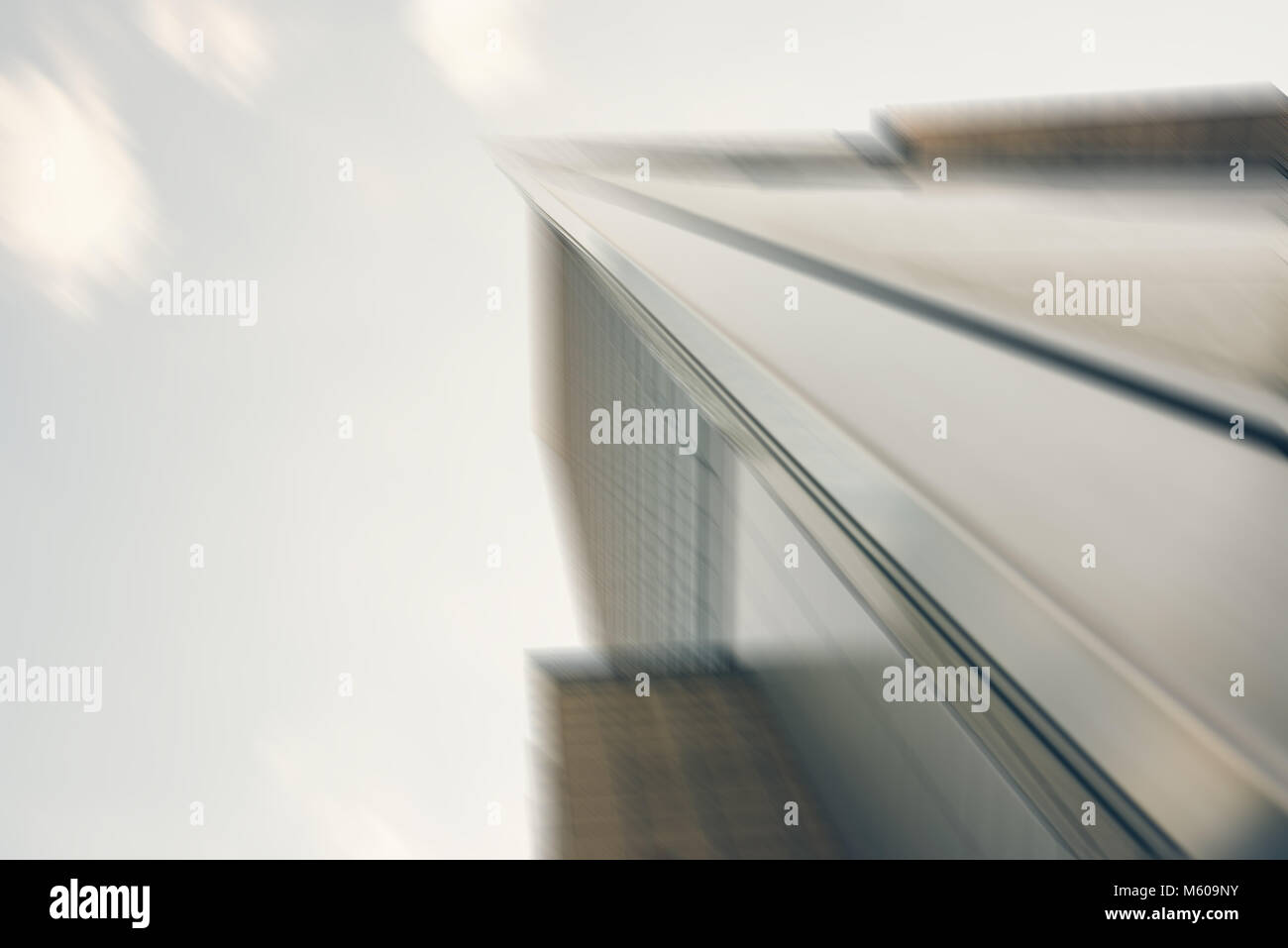 Blurred image of a modern skyscraper rising up into the sky - Stock Image