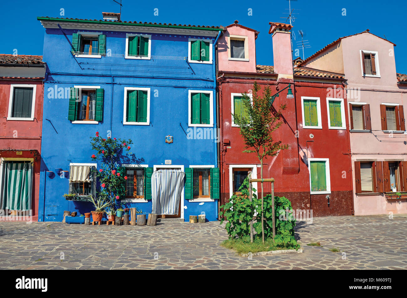 Burano, Italy - May 08, 2013. Overview of colorful terraced houses on sunny day in Burano, a gracious little town Stock Photo