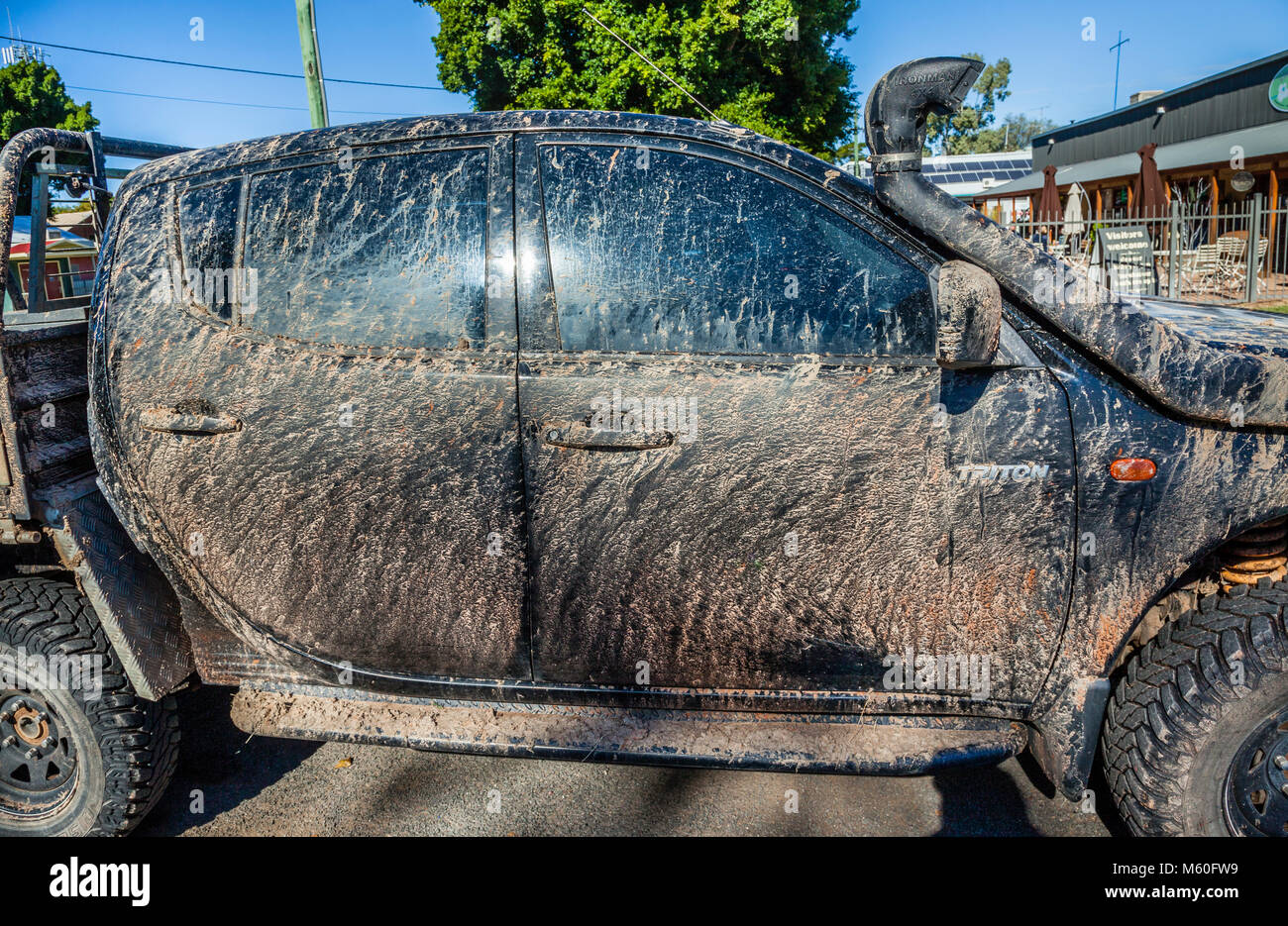 Australia, North-West New South Wales, Bourke, mud vovered 4WD vehicle after some rough outback travel - Stock Image