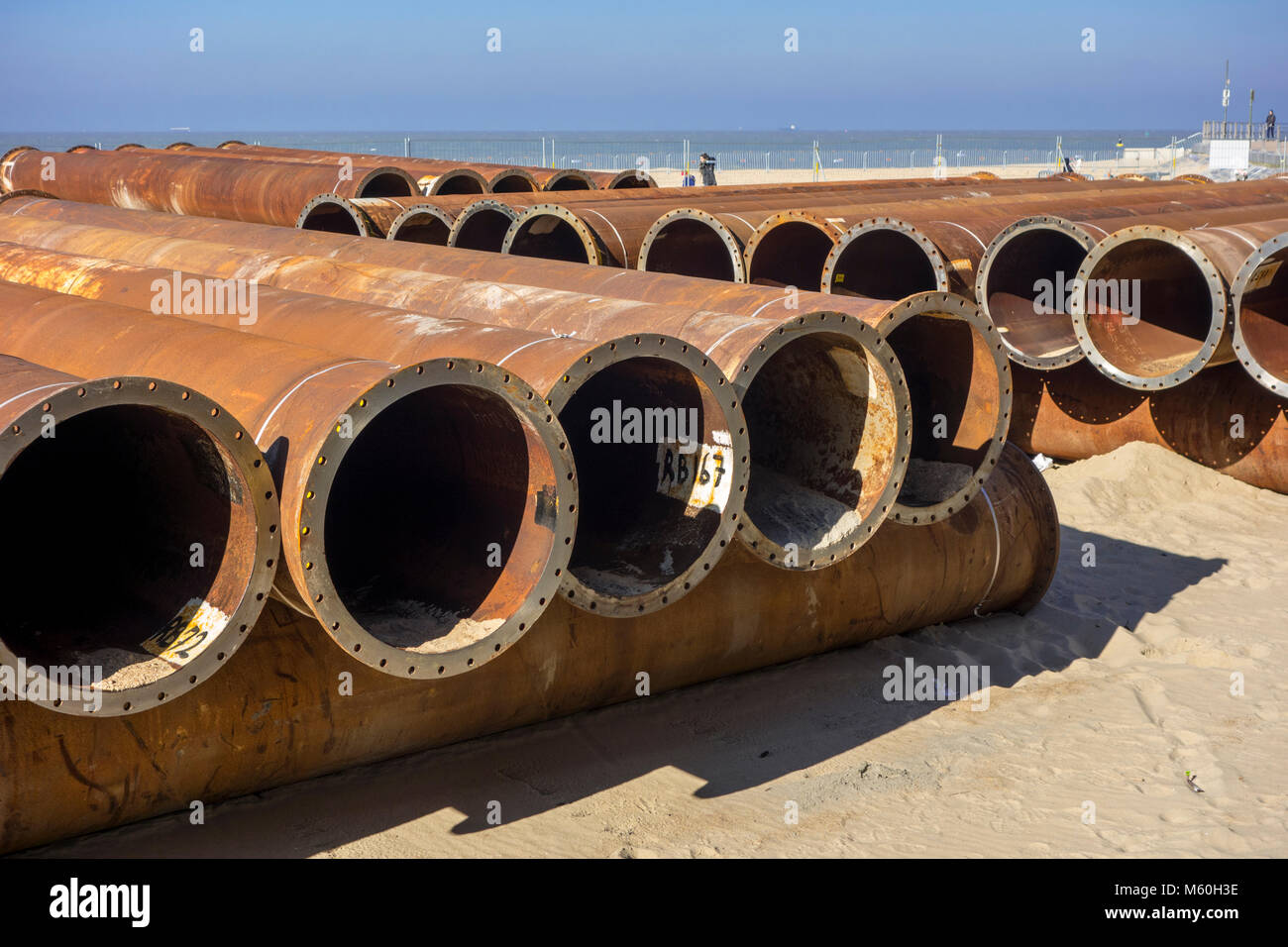 Pipeline tubes for sand replenishment / beach nourishment to make wider beaches to reduce storm damage to coastal - Stock Image
