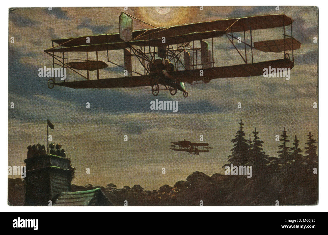 "Old German postcard ""night flight of the British military aviation unit"" Biplane over pine trees in the sky. The Stock Photo"