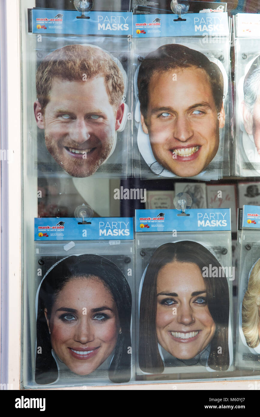 Windsor, UK. 27th February, 2018. Masks featuring images of Prince Harry and Meghan Markle on sale in a gift shop. Stock Photo