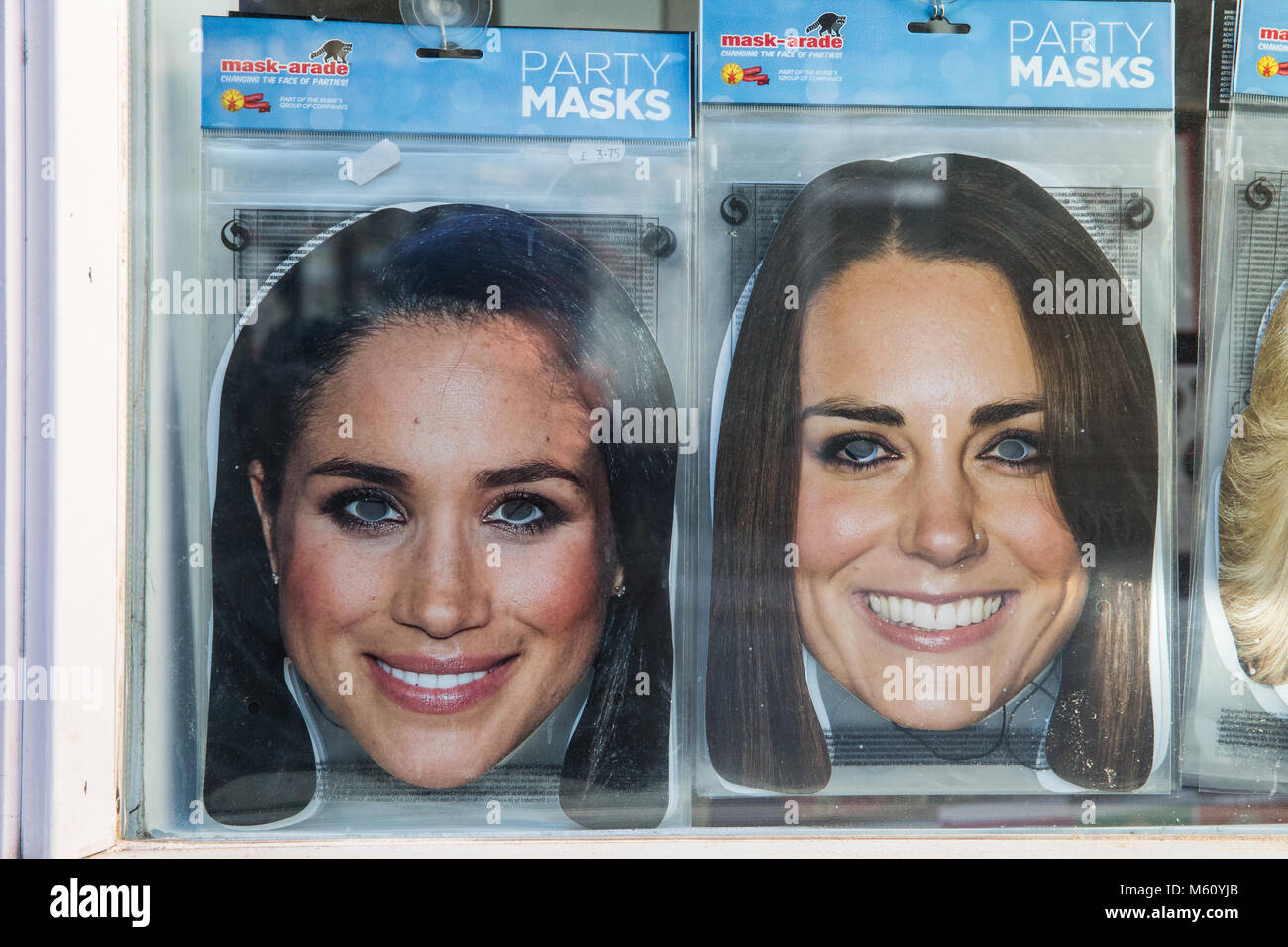 Windsor, UK. 27th February, 2018. Masks featuring images of Meghan Markle and Kate Middleton on sale in a gift shop. Stock Photo