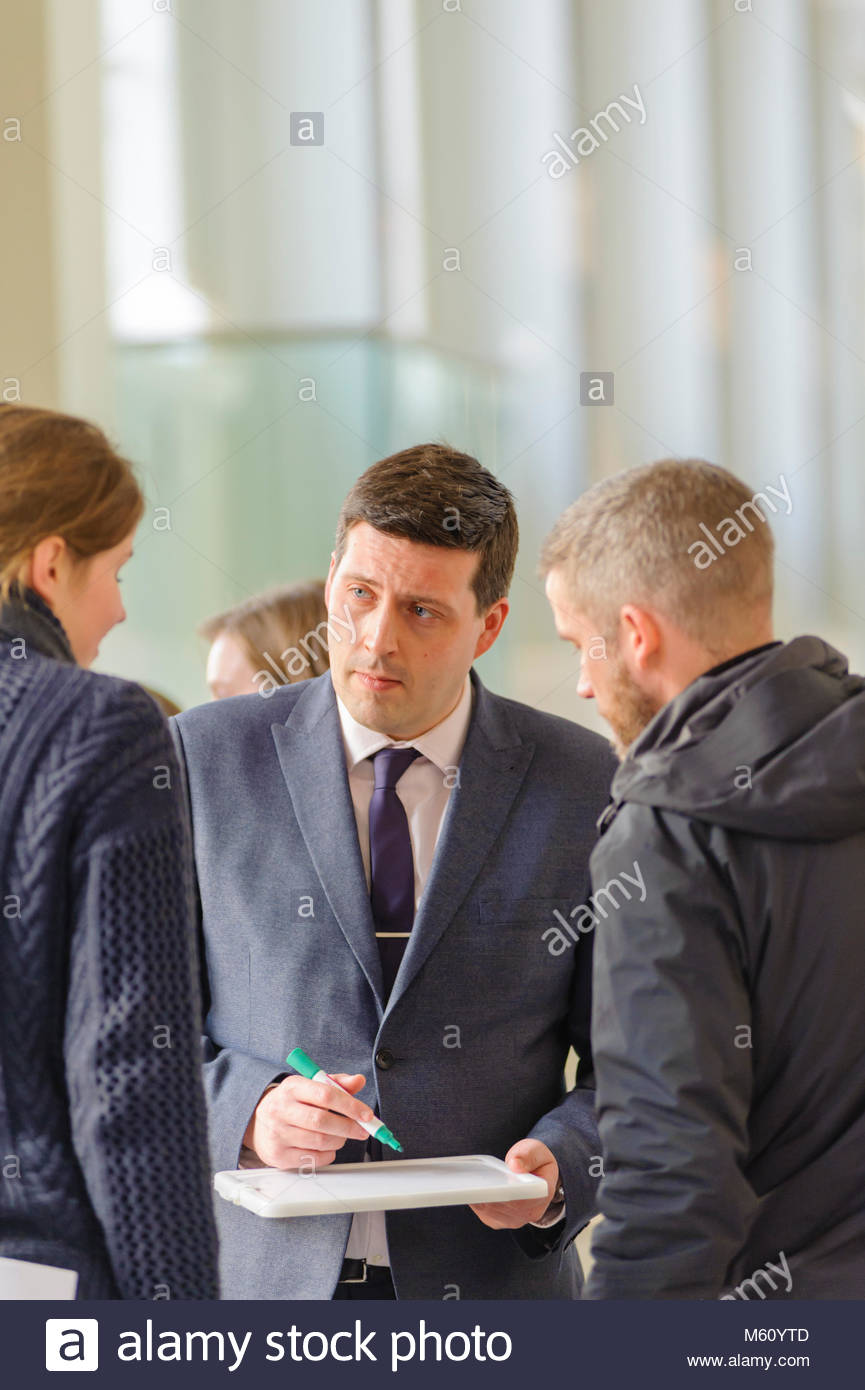 Edinburgh, UK. 27th February, 2018.   Minister for Employability and Training Jamie Hepburn during his visit to - Stock Image