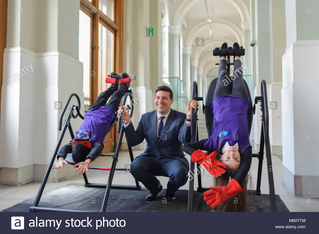 Edinburgh, UK. 27th February, 2018.  Students demonstrate inversion tables to Minister for Employability and Training - Stock Image