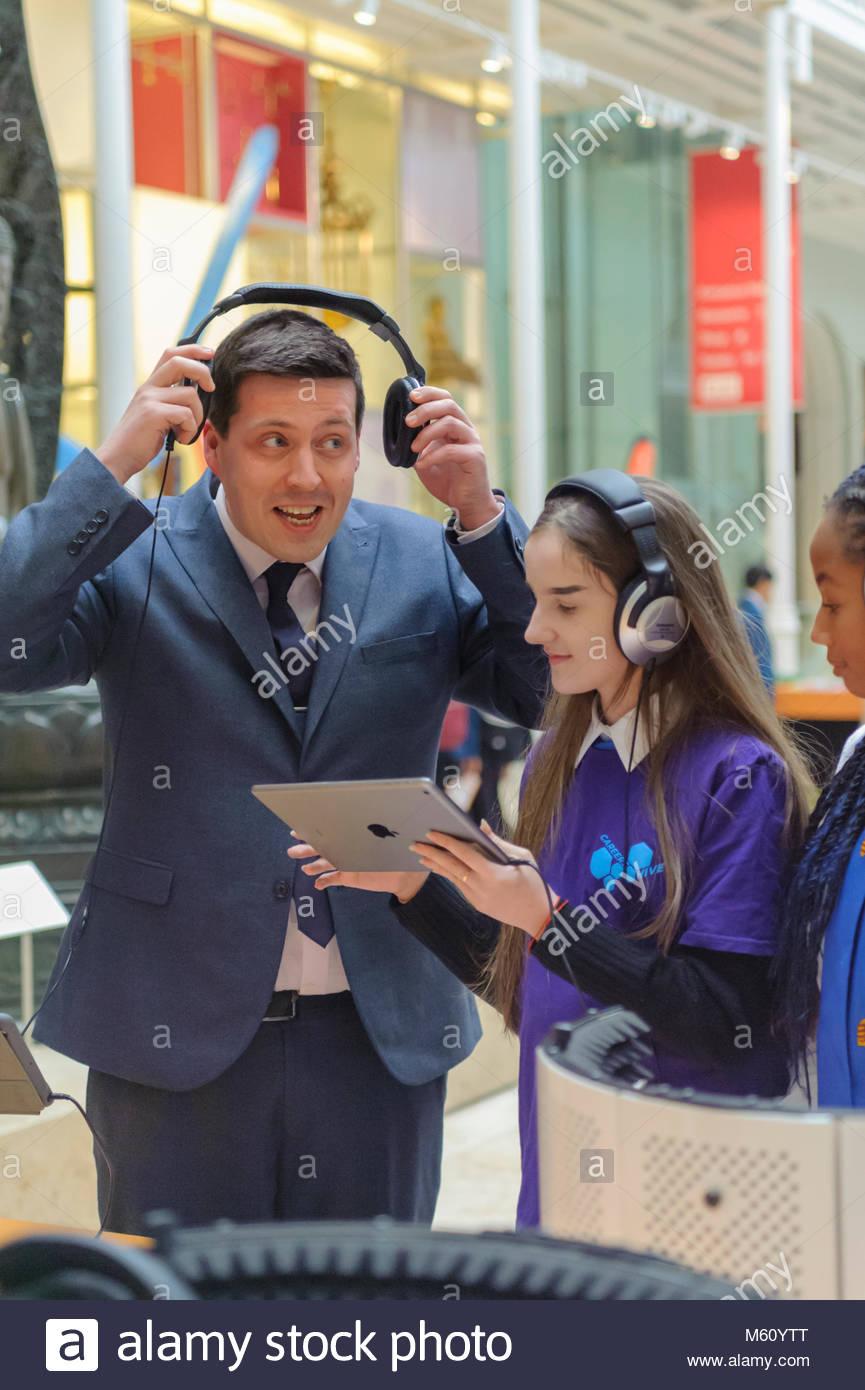 Edinburgh, UK. 27th February, 2018.  Jamie Hepburn MSP Minister for Employability and Training tries out a radio - Stock Image
