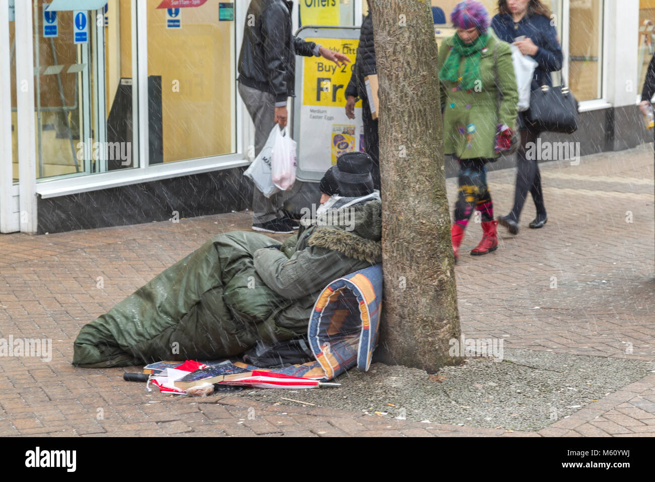 Northampton. U.K. 27th February 2018. Weather. Homeless in Abinging street, Northampton town centre wrapped up against - Stock Image