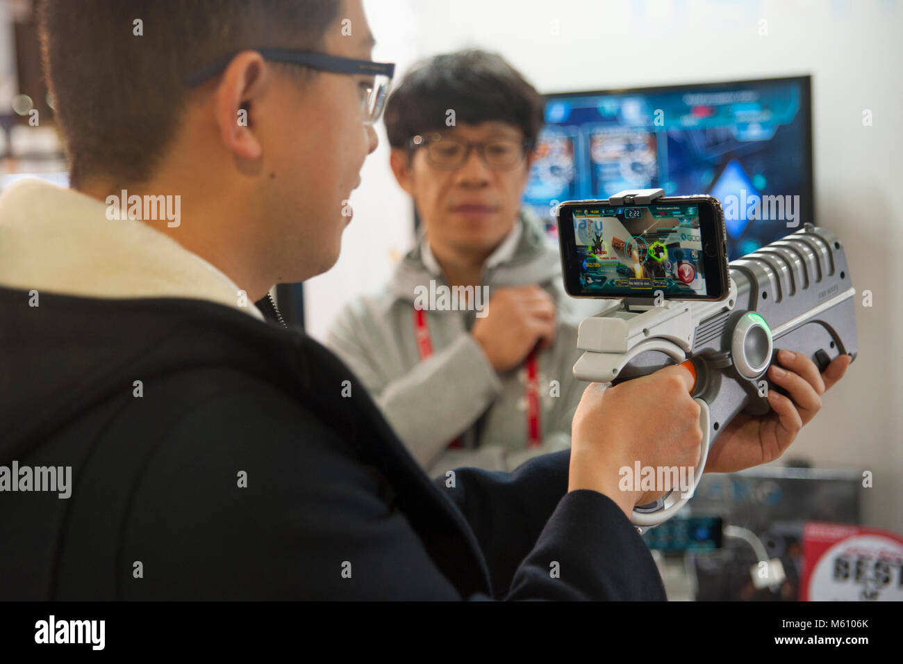 Barcelona, Spain. 27 feb, 2018.  A young man tries a gadget to play war games with the mobile device. 4YFN is the - Stock Image