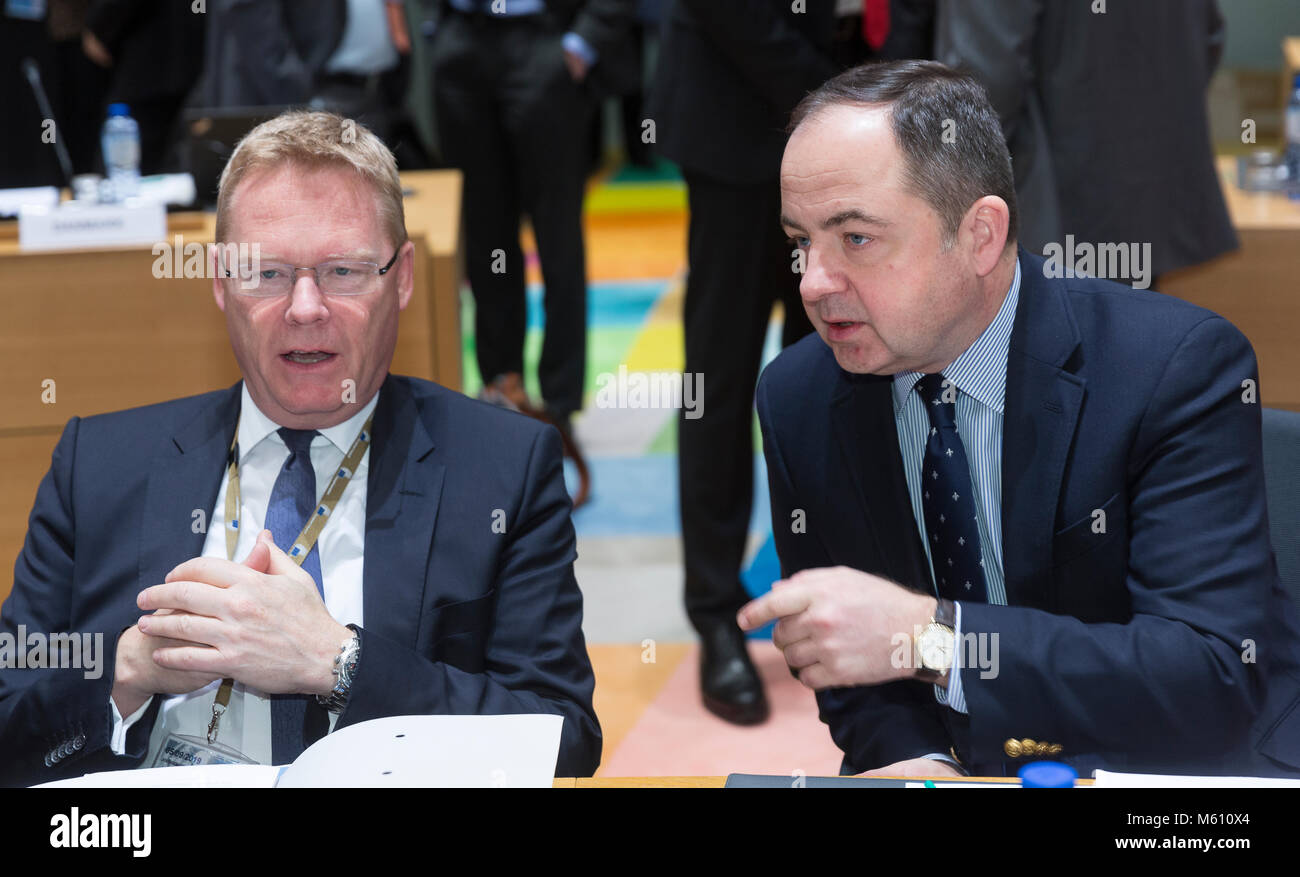Brussels, Belgium - February 27, 2018: Danish permanent representative Kim Jorgensen (L) is talking with the Polish - Stock Image