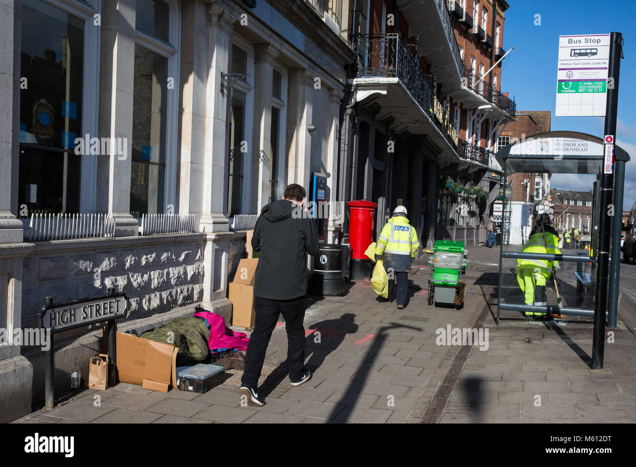Windsor, UK. 27th February, 2018. A homeless person sleeps in the High Street opposite Windsor Castle after a night - Stock Image