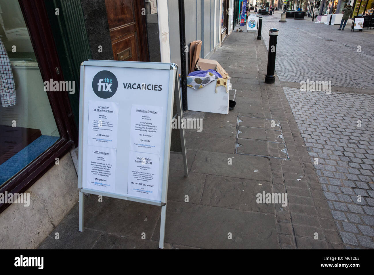 Windsor, UK. 27th February, 2018. A homeless person sleeps in the High Street after a night of below-freezing temperatures. - Stock Image