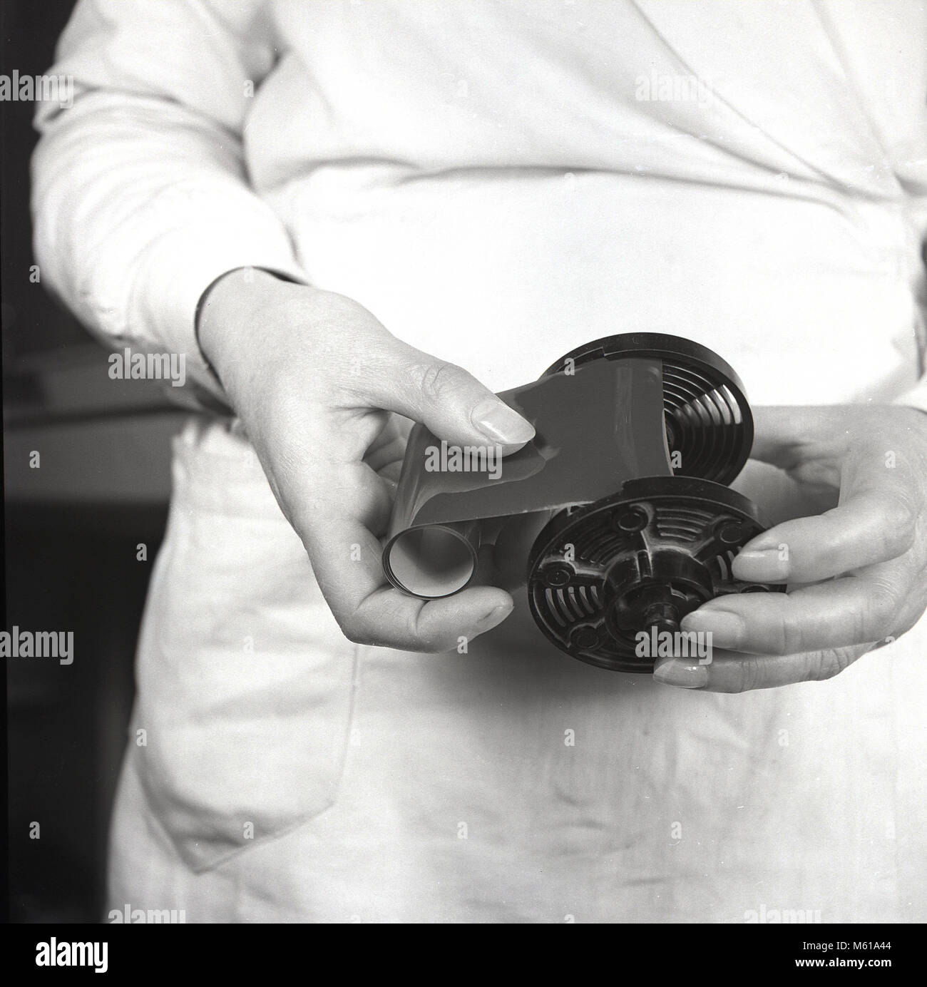 1950s, historical, close-up of a roll of celluloid film on a roll holder. The invention of flexible celluloid film - Stock Image
