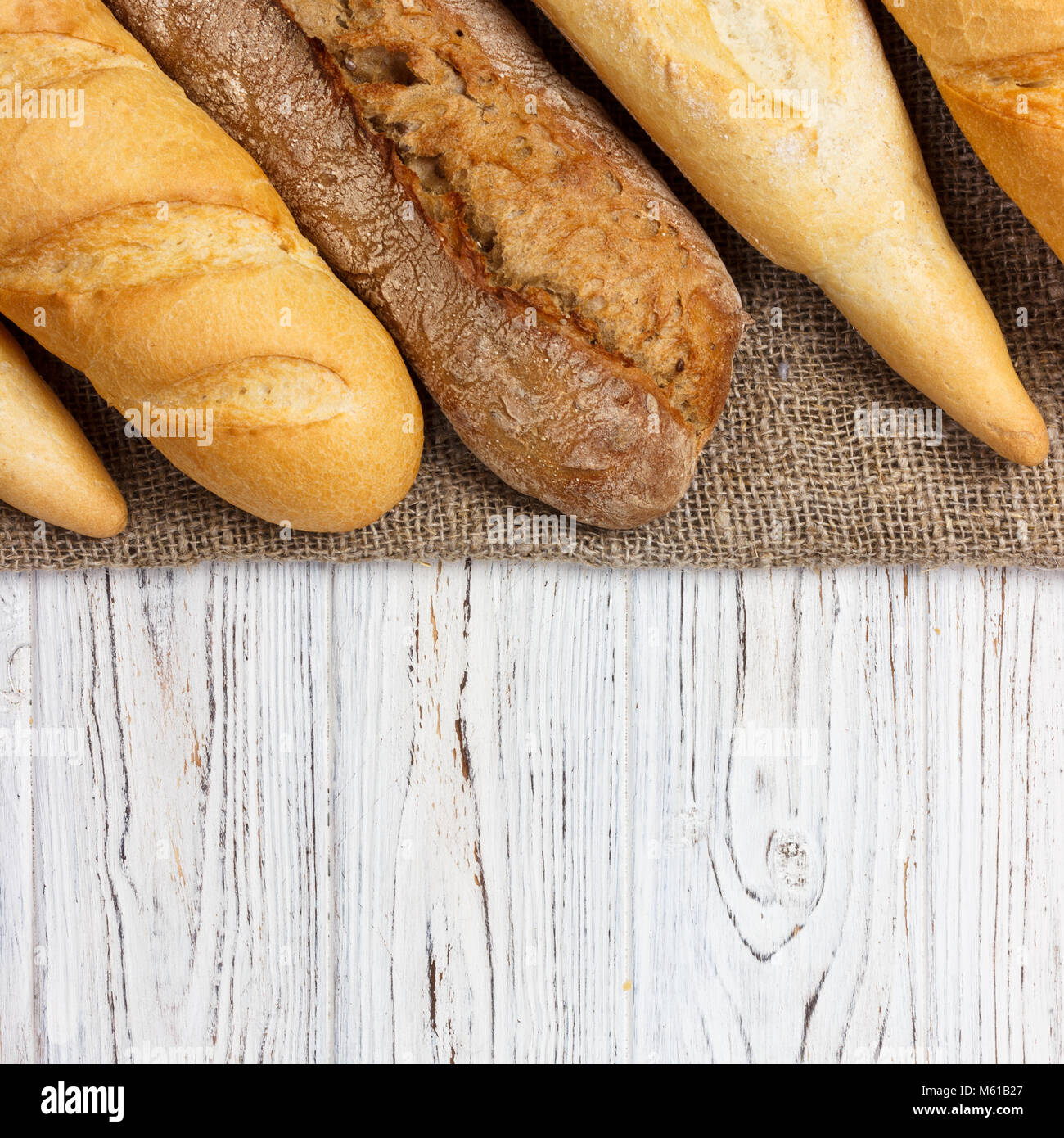 Homemade baguettes on wooden table. close up. - Stock Image