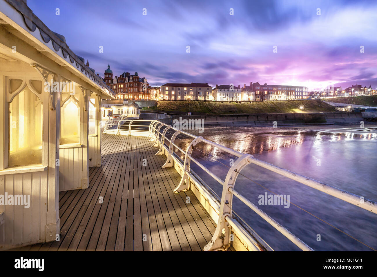 Cromer Pier Victorian Shelters - One of the greatest piers in England jutting out from Cromer town in Norfolk. The Stock Photo