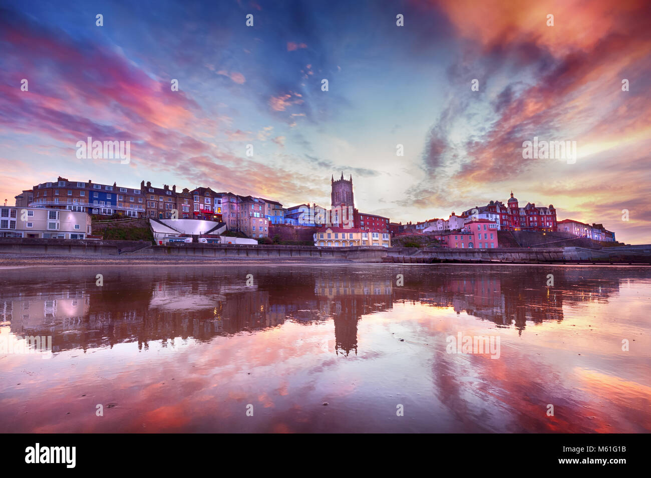 Skies ablaze in Cromer town - Fabulous looking sky and reflection surround the picturesque seaside town of Cromer. Stock Photo