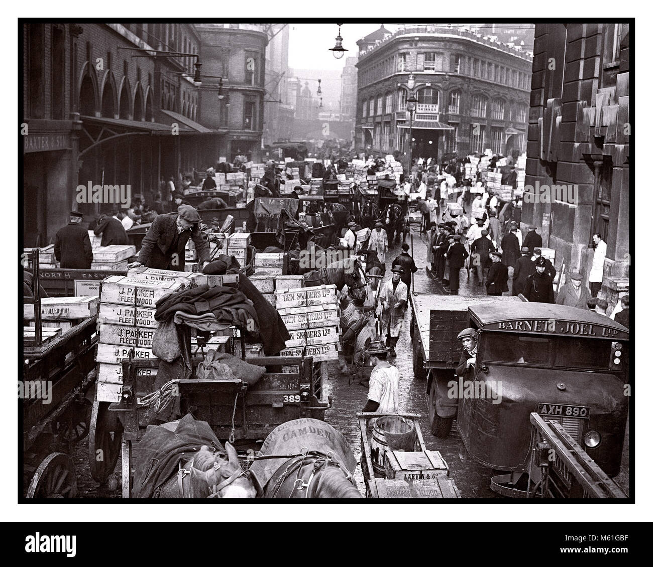Vintage 1930's London Market Billingsgate Fish Market busy street scene of a variety of collections and deliveries - Stock Image