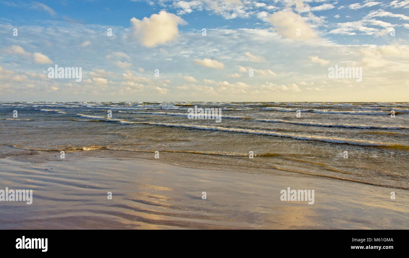 Liepaja Baltic sea beach on an sunny day with fluffy clouds day, Latvia - Stock Image
