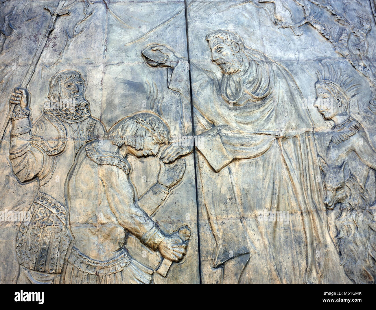 Details of the main south doors of the  Basílica del Voto Nacional showing the baptism of native people by - Stock Image