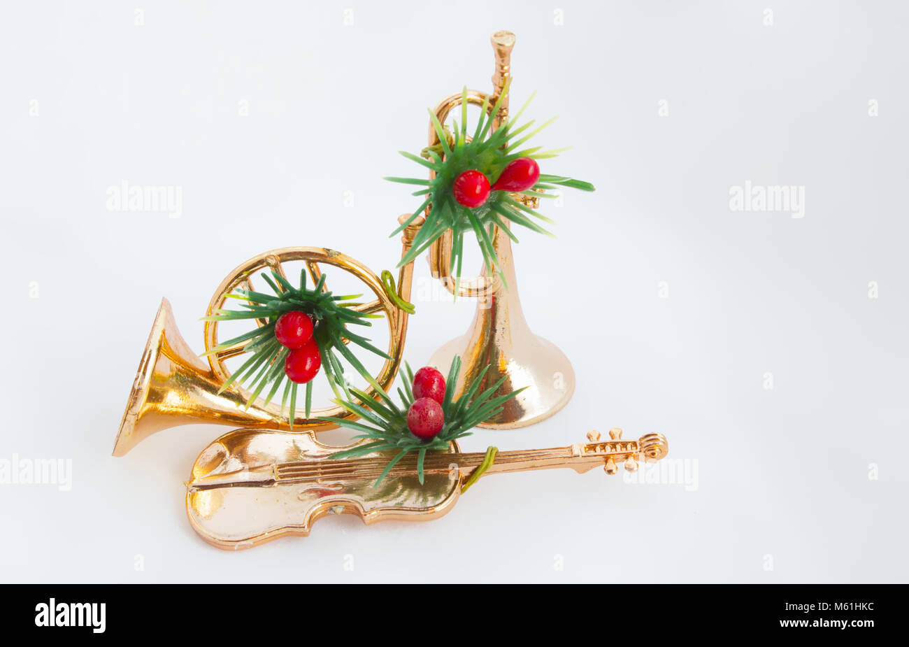 Christmas Trumpet Images.The Trumpet Horn And Violin Festively Decorated On The White