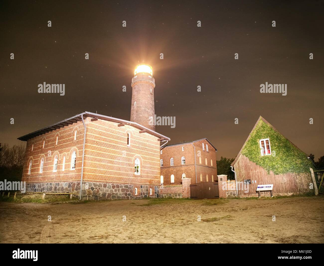 Lighthouse at Darsser Ort is shining in dark night. National park at Prerow, Baltic Sea,  Mecklenburg-West Pomerania, - Stock Image