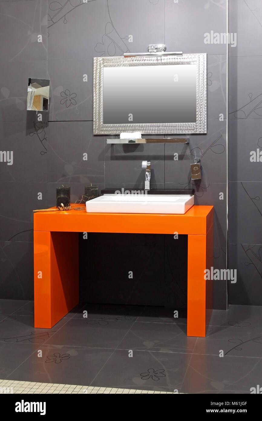 Modern Bathroom Interior With Contemporary Orange Basin Stock