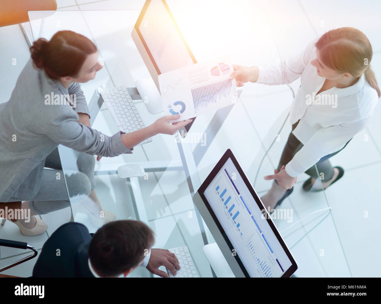 view from the top. senior Manager conveys to the employee the financial document. - Stock Image