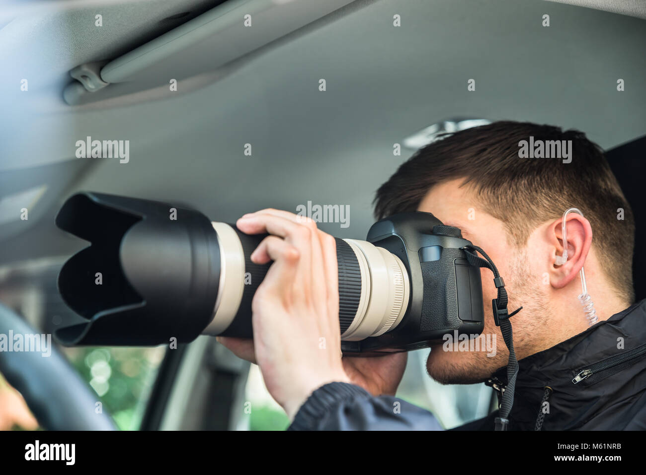 Close-up Of A Young Man Inside Car Photographing With Slr Camera - Stock Image