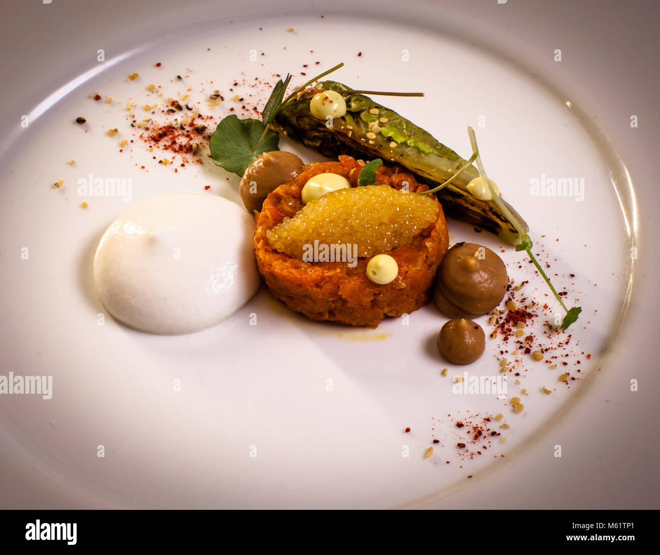 Carrots Tatar with beans miso, pike caviar and sheep's milk by Michelin Star Chef Marco Müller Stock Photo