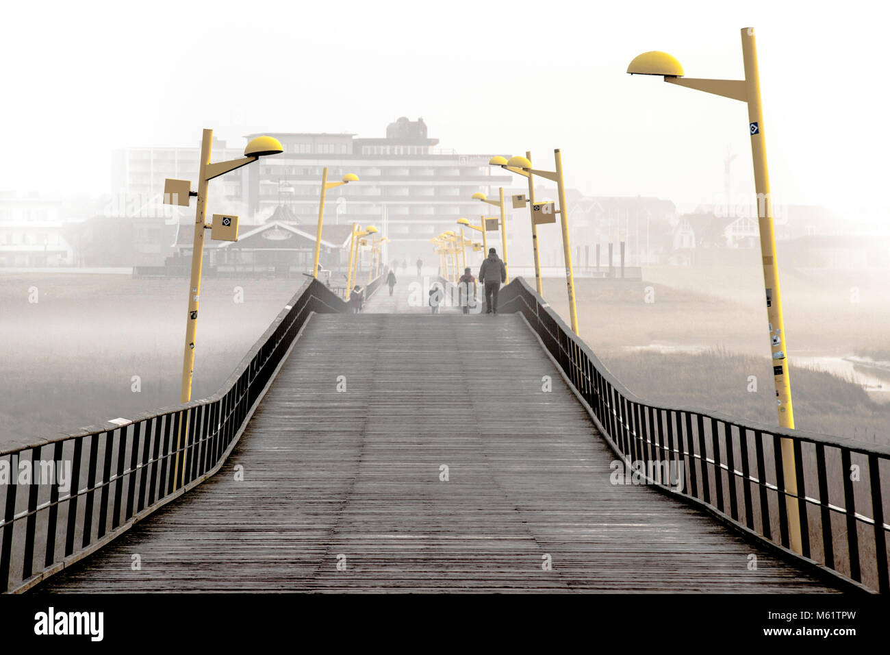 Starting point and destination for extensive hikes: The Ambassador Hotel & Spa and promenade pier in St Peter Ording, seaside resort, Germany Stock Photo