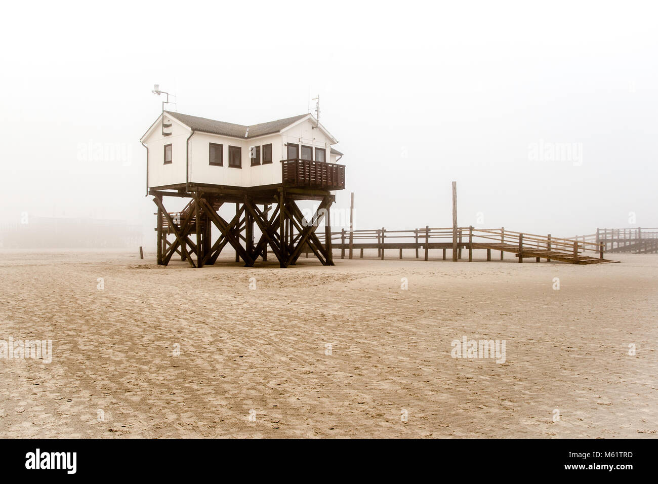 The pile dwellings rise up to seven meters above the beach. For more than 100 years, the constructions made of larch wood have shaped the beach image of St. Peter-Ording. Lake dwelling, pier house at the beach of St Peter Ording in Germany Stock Photo