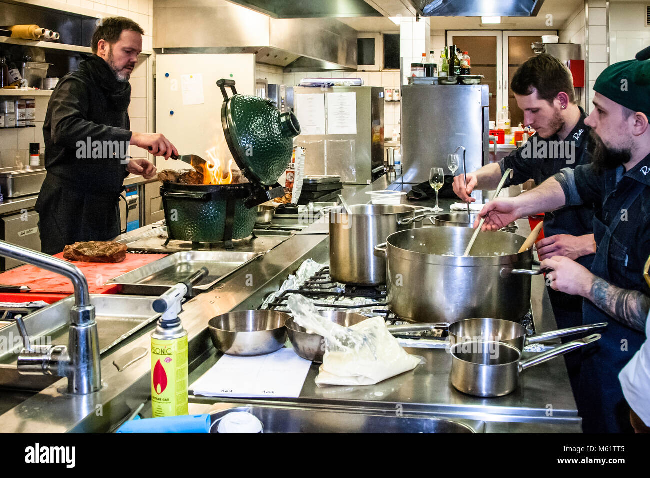 German Michelin star chef Marco Müller and his team Stock Photo