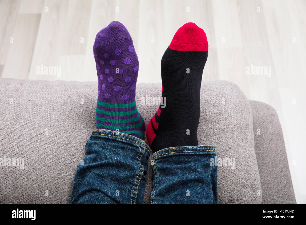 Close-up Of A Human Feet With Dotted And Striped Pattern Socks - Stock Image