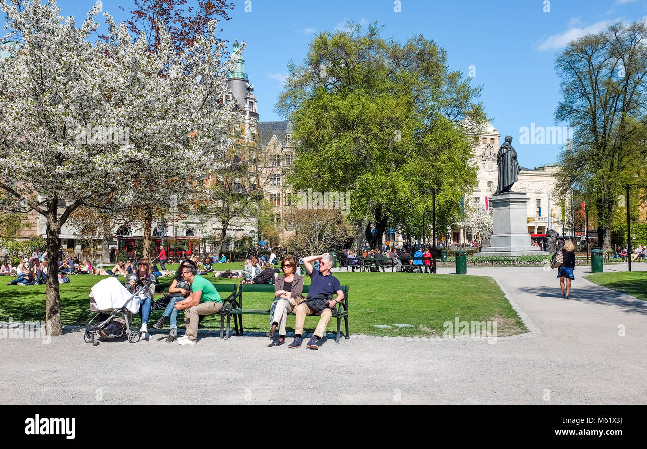 People relax in Berzelii park during springtime in Stockhom. This is one of the most central parks in the city of - Stock Image